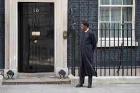 Buhari stads outside british parliament