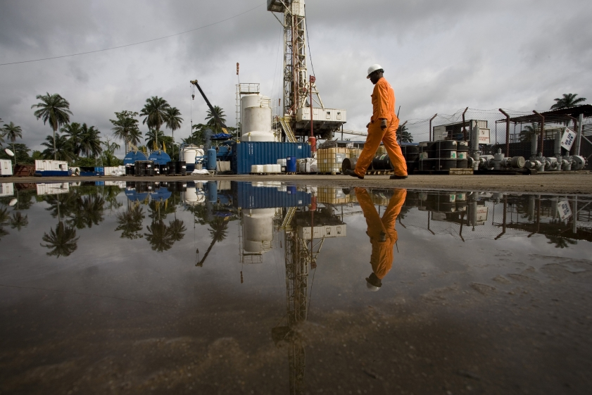 man walking on oil site