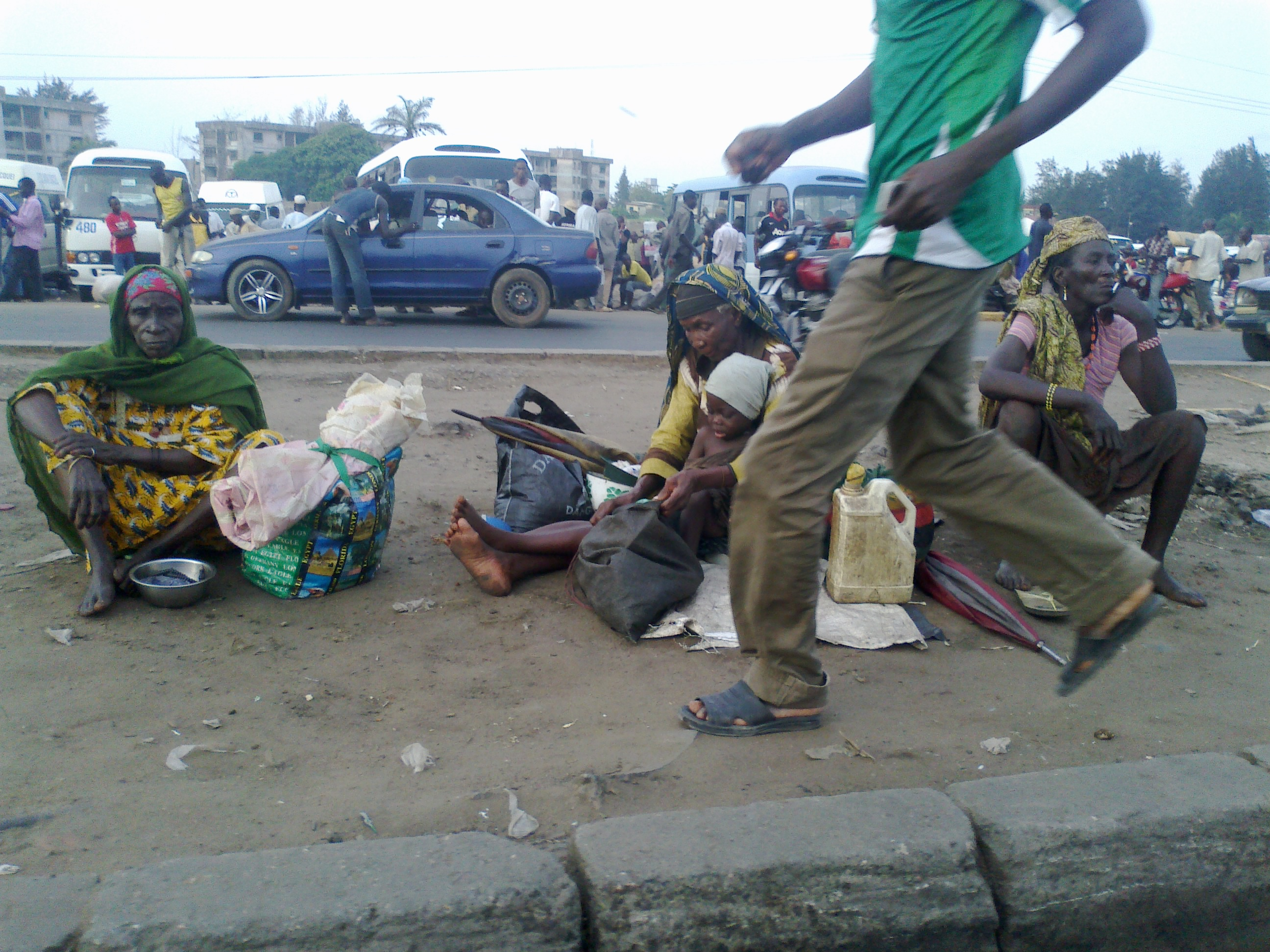 poor people on street nigeria.jpg