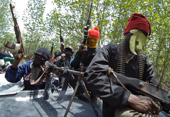 Masked Ateke Tom militants hold their gu